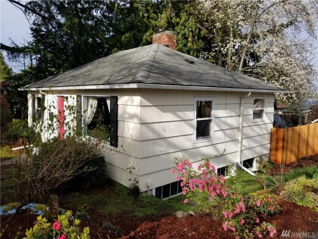 9814 35th Ave SW, Seattle, WA 98126 (#1418899) :: Keller Williams Everett
