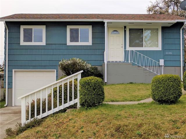 1126 E 52nd St, Tacoma, WA 98404 (#1425436) :: Keller Williams Realty