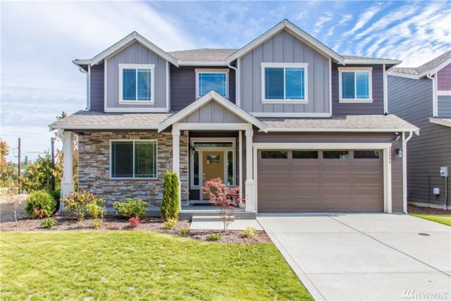 12801 107th Av Ct E, Puyallup, WA 98374 (#1425672) :: Alchemy Real Estate