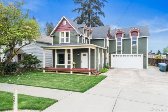 1207 9th Ave SW, Puyallup, WA 98371 (#1428166) :: McAuley Homes