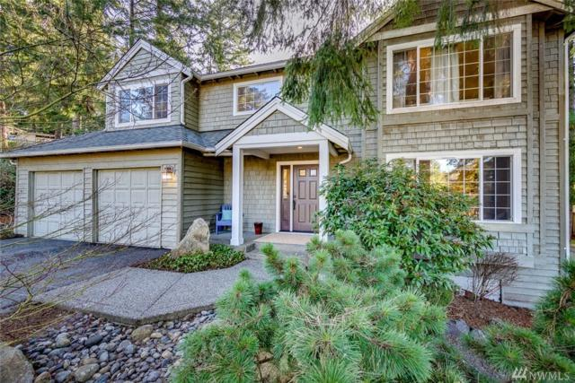 9225 NE Bluefin Ct, Bainbridge Island, WA 98110 (#1428488) :: Keller Williams Everett