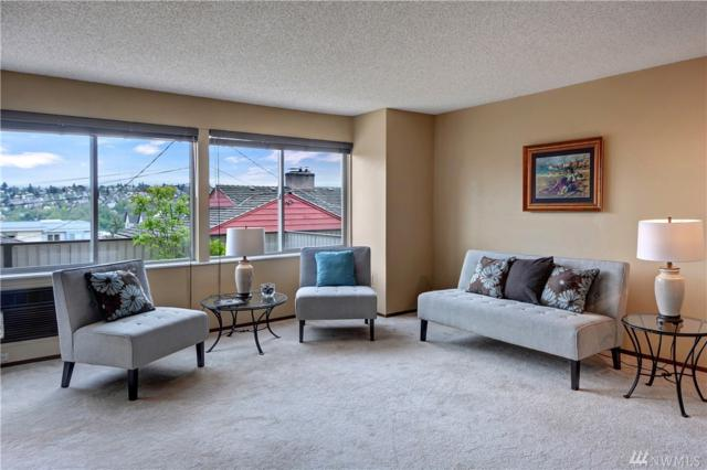 1964 26th Ave W #102, Seattle, WA 98199 (#1429144) :: Commencement Bay Brokers