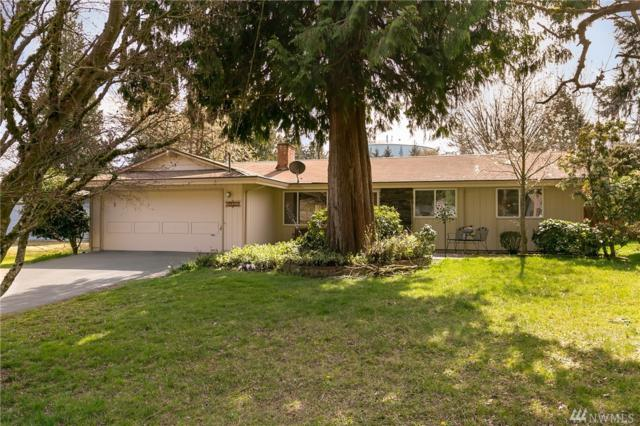 13021 NE 109th Place, Kirkland, WA 98033 (#1432387) :: Keller Williams Everett