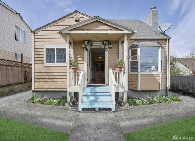 9101 Rainier Ave S, Seattle, WA 98118 (#1435017) :: McAuley Homes