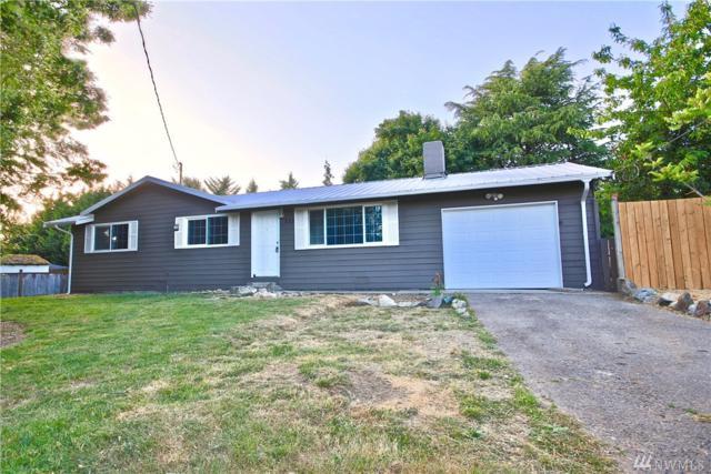 822 S 193rd Place, SeaTac, WA 98148 (#1435617) :: McAuley Homes