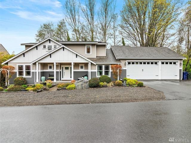 8409 S 18th St, Tacoma, WA 98465 (#1436613) :: Keller Williams Western Realty