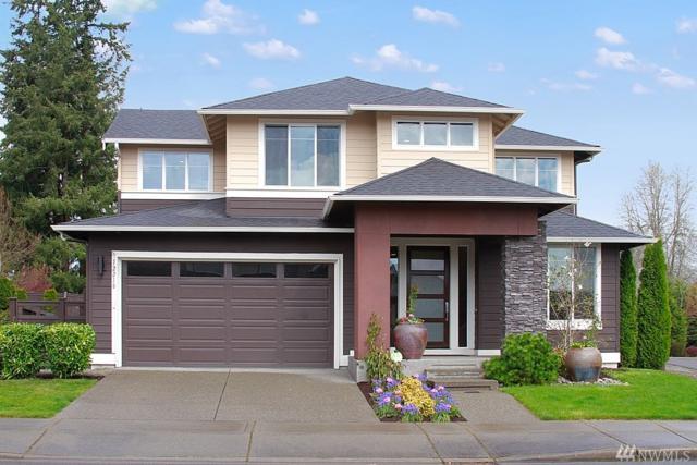 12218 SE 288th Place, Auburn, WA 98092 (#1436640) :: McAuley Homes