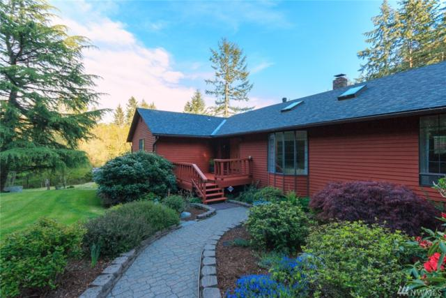 9491 Bucsit Lane NE, Bainbridge Island, WA 98110 (#1436648) :: Keller Williams Western Realty