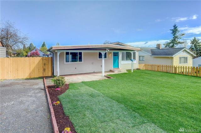 1023 E 45th St, Tacoma, WA 98404 (#1436718) :: Keller Williams Realty