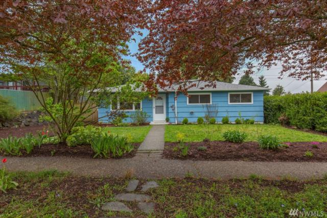 7947 13th Ave SW, Seattle, WA 98106 (#1436779) :: KW North Seattle