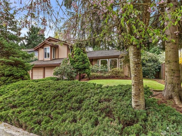 11731 SE 65th St, Bellevue, WA 98006 (#1437996) :: Real Estate Solutions Group