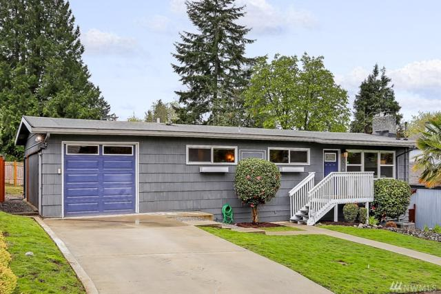 2845 SW 111th Place, Seattle, WA 98146 (#1438505) :: Hauer Home Team