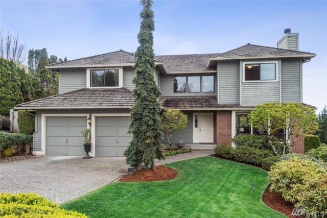 7041 NE 164th St, Kenmore, WA 98028 (#1439634) :: McAuley Homes