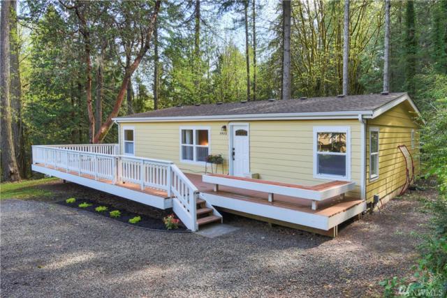 8480 NE Hansen Rd, Bainbridge Island, WA 98110 (#1440620) :: KW North Seattle