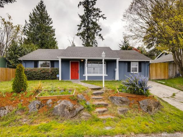 9220 23rd Ave SW, Seattle, WA 98106 (#1440807) :: The Kendra Todd Group at Keller Williams