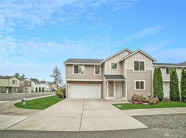 11612 4th Ave E, Tacoma, WA 98445 (#1441114) :: Keller Williams Everett