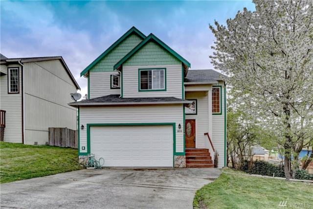 1121 E 55th St, Tacoma, WA 98404 (#1441148) :: Northern Key Team