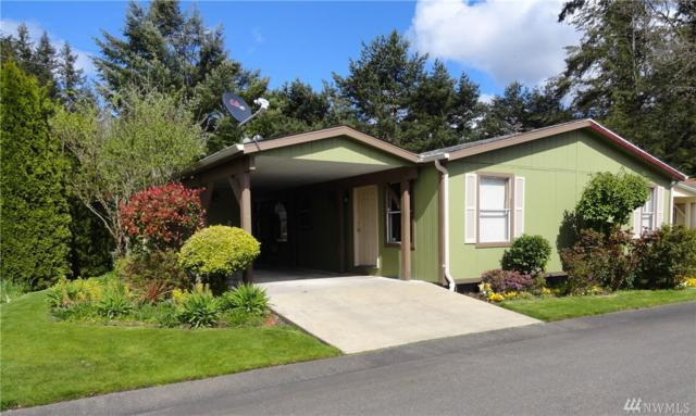 1827 137th St E #102, Tacoma, WA 98445 (#1441425) :: Hauer Home Team