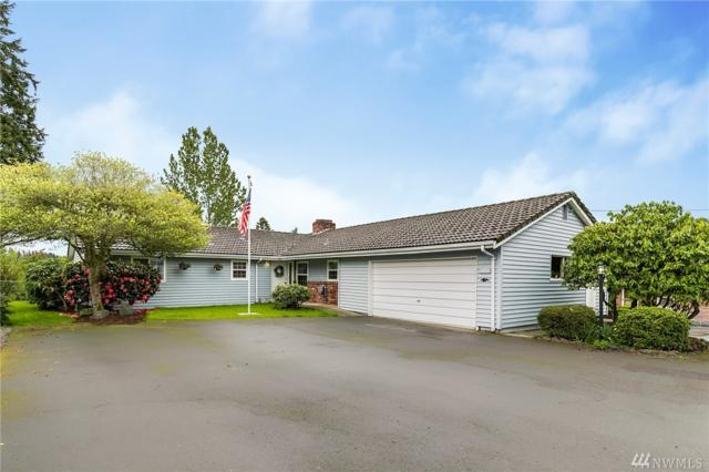1125 S Rainbow Lane, Des Moines, WA 98198 (#1443507) :: Sarah Robbins and Associates