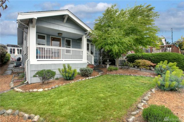 4045 38th Ave SW, Seattle, WA 98126 (#1444735) :: TRI STAR Team | RE/MAX NW