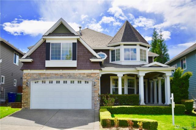 1707 SE 8th St, Renton, WA 98057 (#1447207) :: Homes on the Sound