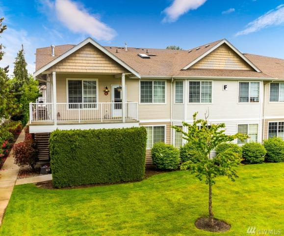 1002 9th Ave SE F202, Puyallup, WA 98372 (#1454359) :: Homes on the Sound