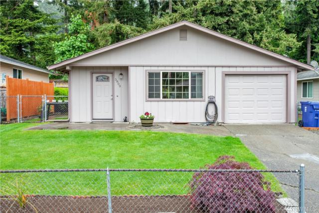 5809 E Swan Creek Dr, Tacoma, WA 98404 (#1456823) :: McAuley Homes