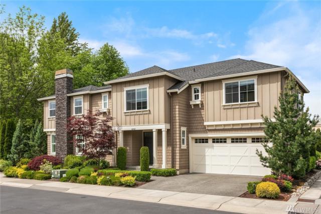 10702 NE 65th Lane, Kirkland, WA 98033 (#1456978) :: Real Estate Solutions Group