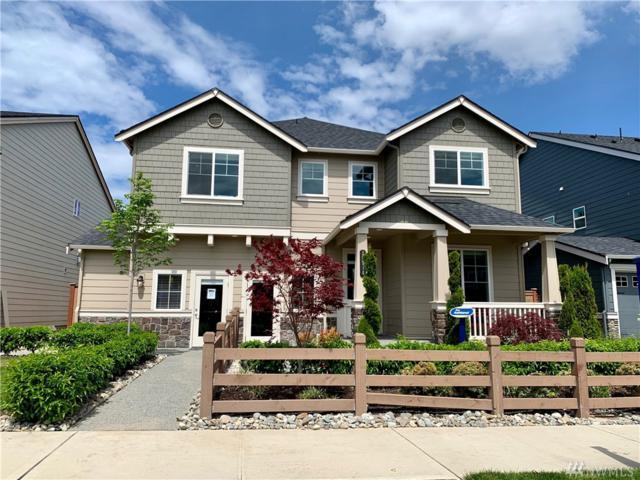 12514-NE 152nd St #122, Woodinville, WA 98072 (#1460072) :: Keller Williams Realty Greater Seattle
