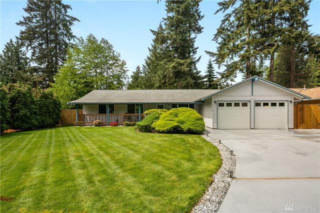 19219 133rd Place NE, Woodinville, WA 98072 (#1460910) :: Homes on the Sound