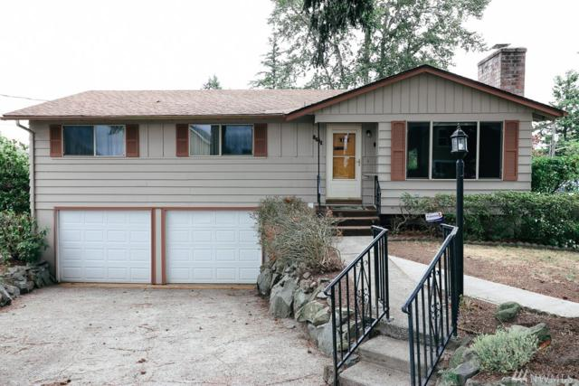 8611 S Ainsworth Ave, Tacoma, WA 98444 (#1462495) :: Kimberly Gartland Group
