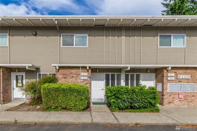 5711 SE 122nd Place SE #216, Bellevue, WA 98006 (#1472724) :: Real Estate Solutions Group