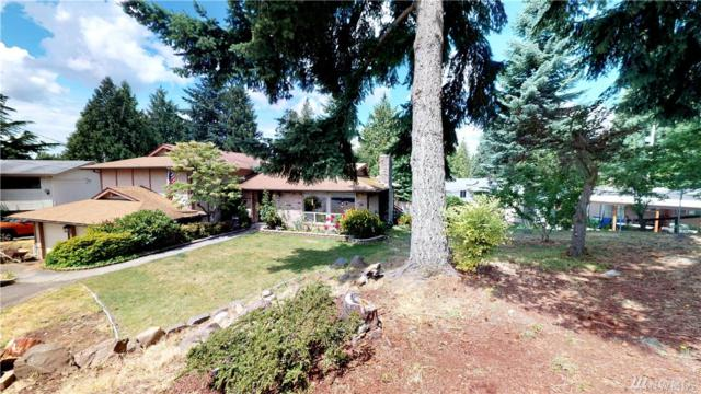 21407 99th Ave S, Kent, WA 98031 (#1474661) :: Real Estate Solutions Group