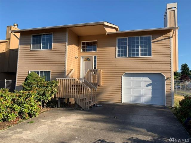 1402 E 59th St, Tacoma, WA 98404 (#1475921) :: Chris Cross Real Estate Group