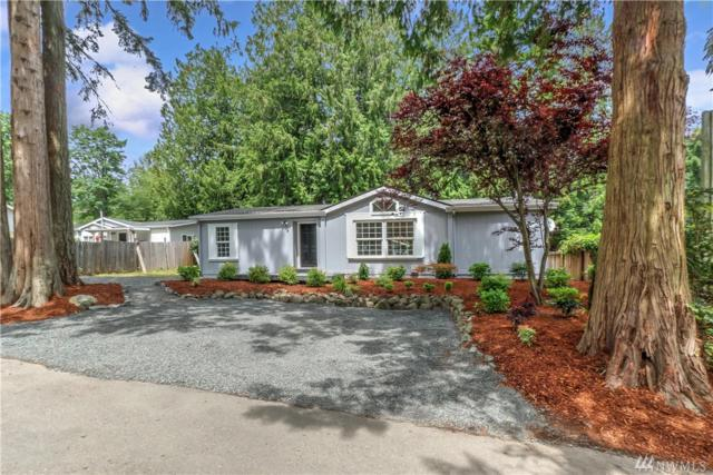 6988 NE Whispering Cedar Lane, Suquamish, WA 98392 (#1476150) :: Better Homes and Gardens Real Estate McKenzie Group