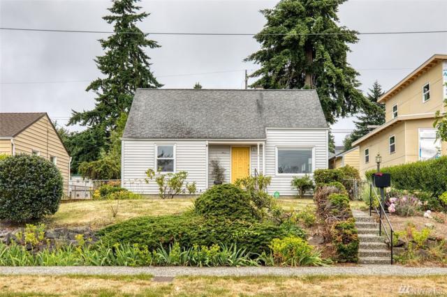 7309 28th Ave SW, Seattle, WA 98126 (#1476857) :: Kwasi Homes