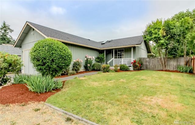 9911 14th Ave E, Tacoma, WA 98445 (#1476902) :: Ben Kinney Real Estate Team