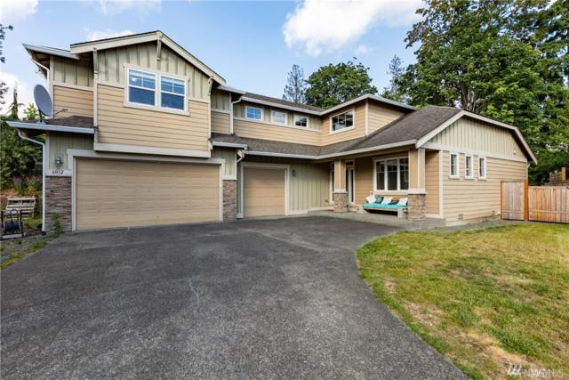 6012 NE 1st Place, Renton, WA 98059 (#1476906) :: Hauer Home Team