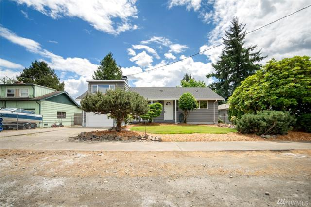 118 E 67th St, Tacoma, WA 98404 (#1479123) :: Kimberly Gartland Group