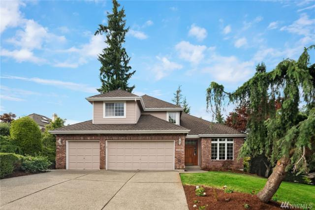 17708 NE 105th St, Redmond, WA 98052 (#1479206) :: Costello Team