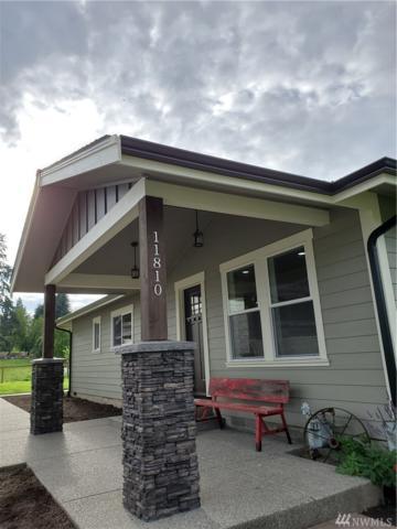 11810 Woodland Ave E, Puyallup, WA 98373 (#1489537) :: The Kendra Todd Group at Keller Williams