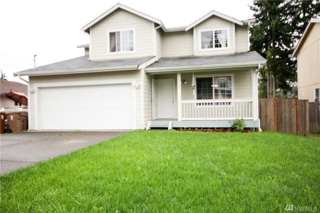 1750 S 93rd St, Tacoma, WA 98444 (#1490066) :: Keller Williams Realty
