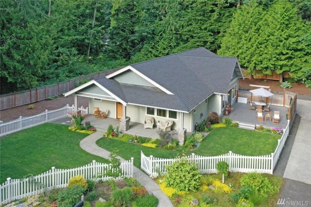 10566 NE Quiet Valley Lane, Bainbridge Island, WA 98110 (#1490873) :: Platinum Real Estate Partners