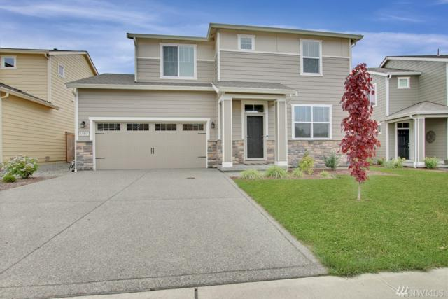13817 66th Ave E, Puyallup, WA 98373 (#1492583) :: Keller Williams Realty Greater Seattle