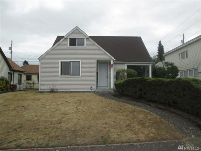 7039 S Puget Sound Ave, Tacoma, WA 98409 (#1492605) :: Keller Williams Realty