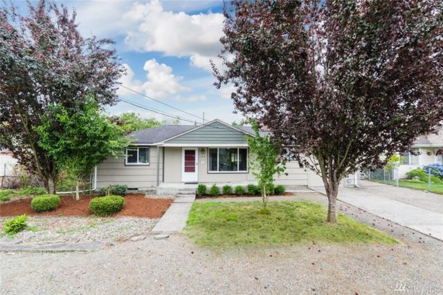 214 S 79th St, Tacoma, WA 98408 (#1492832) :: Ben Kinney Real Estate Team