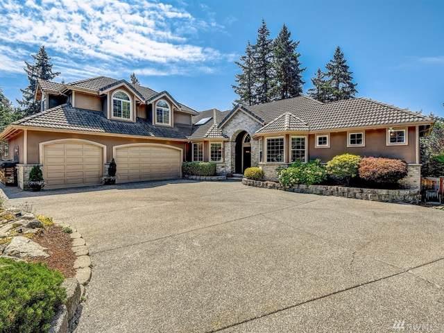 9911 197th Ct NE, Redmond, WA 98053 (#1499790) :: Alchemy Real Estate