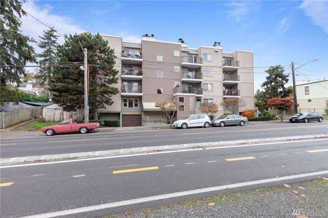 3045 20th Ave W #411, Seattle, WA 98199 (#1503864) :: McAuley Homes