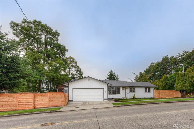 7702 28th Ave SW, Seattle, WA 98126 (#1504506) :: KW North Seattle
