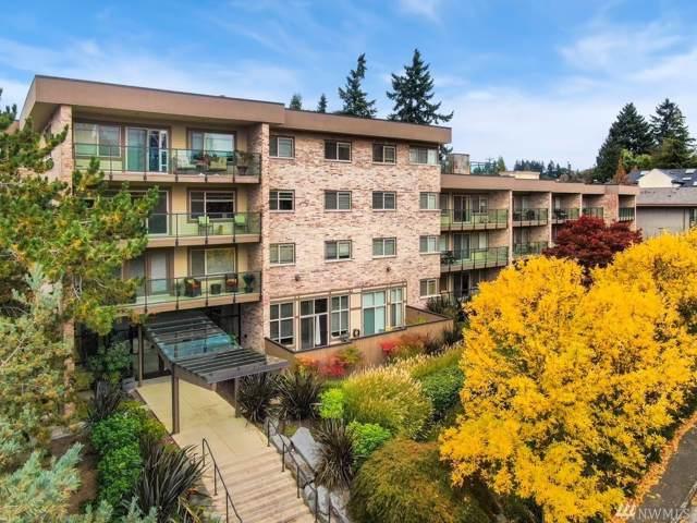 511 100th Ave NE #210, Bellevue, WA 98004 (#1526785) :: KW North Seattle